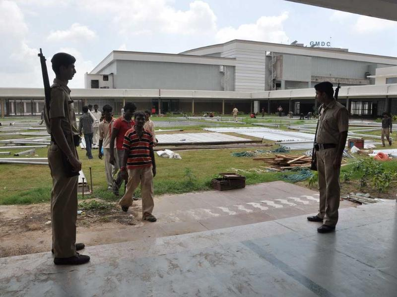 Security personnel stand guard as workers leave the venue of Narender Modi's fast in Ahmedabad today.