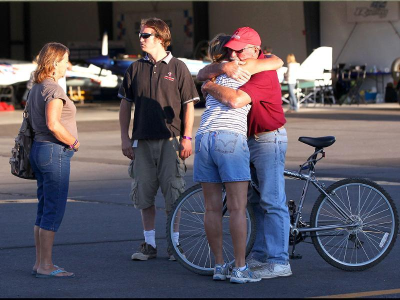 Bystanders embrace after a Second World War fighter plane crashed into the stands at the Reno Air Races in Stead, Nevada.