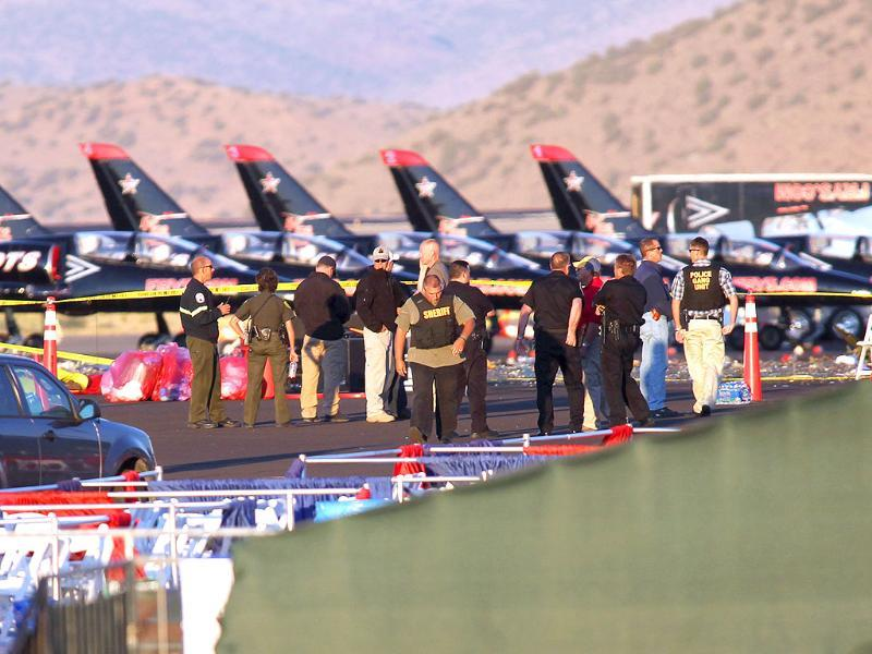 People gather at the scene where a Second World War fighter plane crashed into the stands at the Reno Air Races in Stead, Nevada.