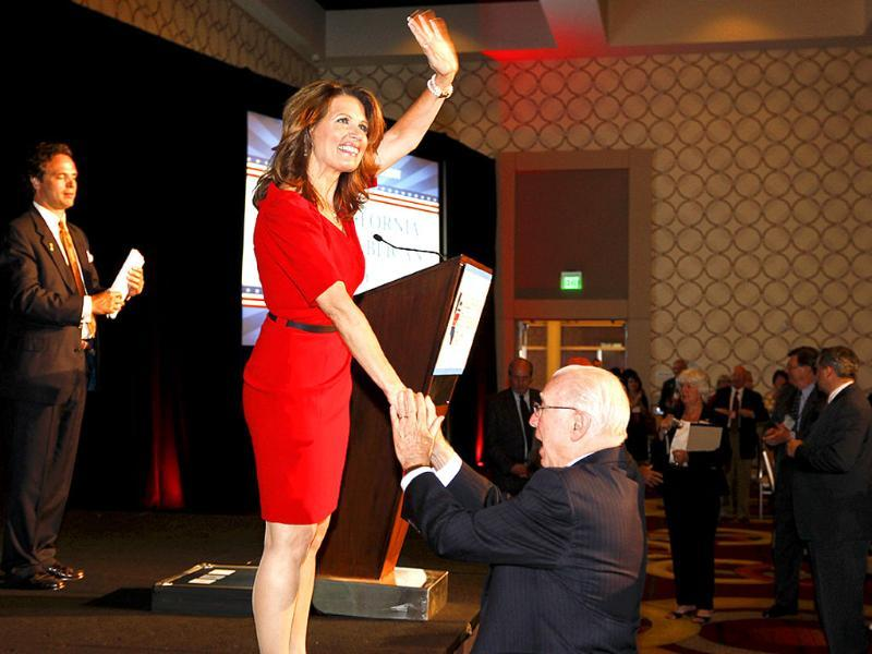 US Republican presidential candidate Rep Michele Bachmann, R-Minn, greets a supporter after the California Republican Party Fall Convention dinner in Los Angeles.