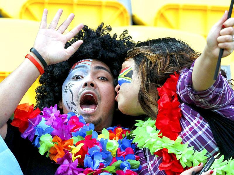 A South Africa Springboks fan kisses a Fiji fan before their Rugby World Cup Pool D match at Wellington Regional stadium in Wellington.