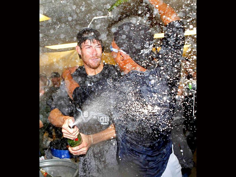 Detroit Tigers pitcher Doug Fister celebrates in the visitors clubhouse after the Tigers clinched the American League Central Division.