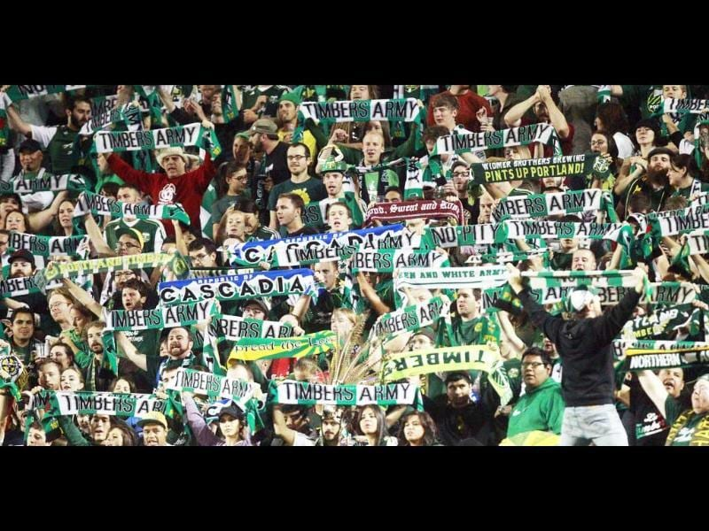 Portland Timbers fans celebrate during an MLS soccer game against the New England Revolution.