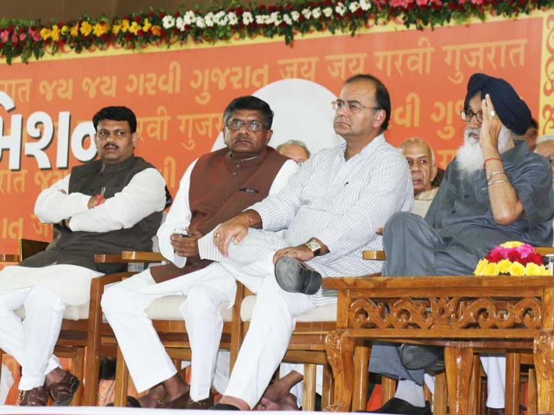 Punjab chief minister Prakash Singh Badal with BJP leaders Arun Jaitley and Ravi Shankar Prasad at the launch of Gujarat chief minister Narendra Modi's three-day fast at Gujarat Convention Centre in Ahmedabad.