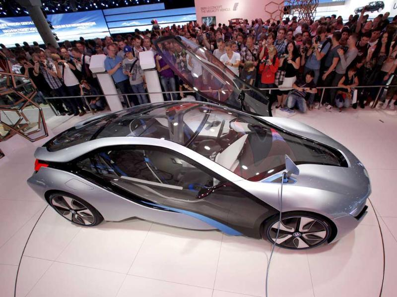 Visitors view the BMW i8 concept car at the 64th International Motor Show (IAA) in Frankfurt. The world's biggest auto show is open to the public and runs until September 25.