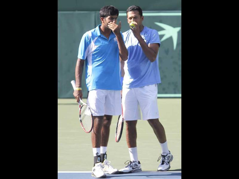 India's Rohan Bopanna (L) talks with Mahesh Bhupathi during their match of the Davis Cup World Group playoff against Japan in Tokyo. India won, 7-5, 3-6, 6-3, 7-6.