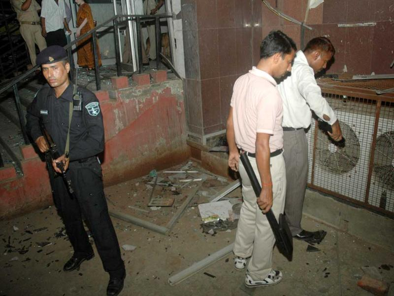 Police personnel investigate the site of explosion at Jai Hospital in Agra.
