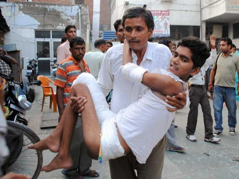 An injured man is taken to the hospital after a blast in Agra.