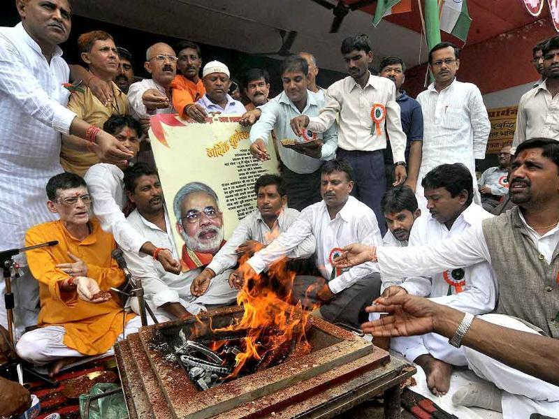 BJP activists perform a 'havan' in support of Gujarat chief minister Narendra Modi, in Patna.