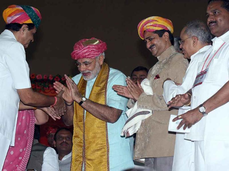 Members of the royal family greet Gujarat chief minister Narendra Modi on the second day of his 72 hour fast at the Gujarat University convention hall in Ahmedabad.