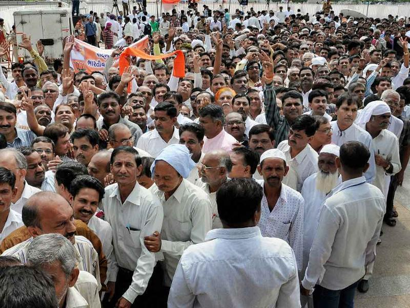 Supporters rush to the hall to meet Gujarat's chief minister Narendra Modi, sitting on the second day of his fast in Ahmedabad.
