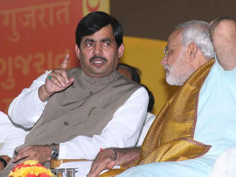 Gujarat chief minister Narendra Modi, with BJP leader Shahnawaz Hussain, on the second day of his 72 hour fast at the Gujarat University convention hall in Ahmedabad.
