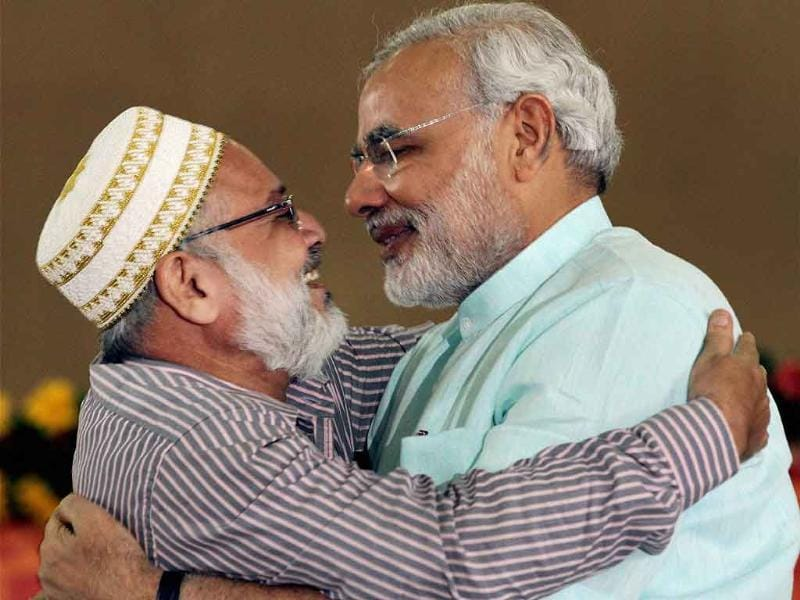 Gujarat's chief minister Narendra Modi greeted by a muslim leader during the second day of his fast in Ahmedabad.