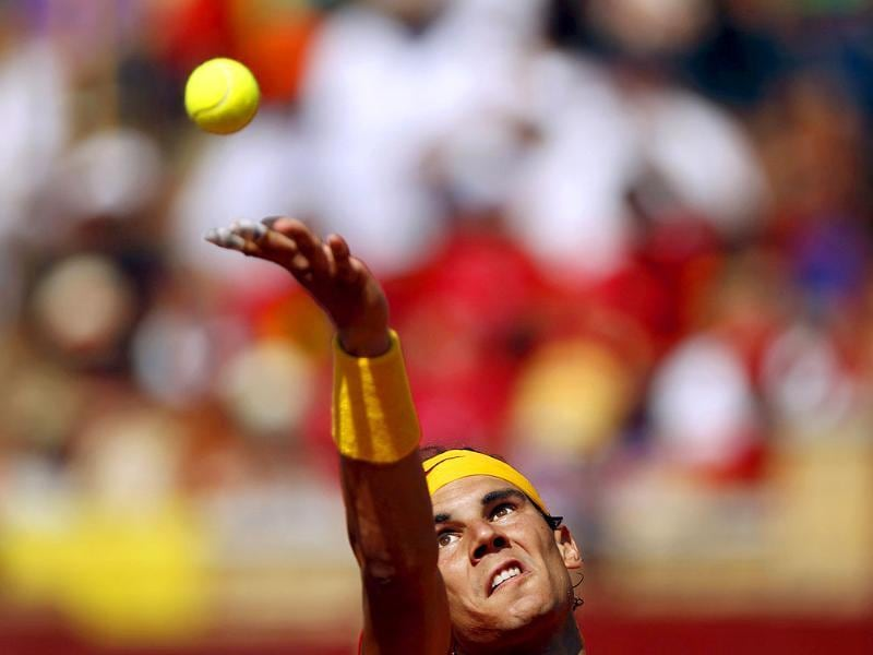 Rafael Nadal of Spain serves to Jo-Wilfried Tsonga of France during their Davis Cup World Group semi-final match at the Cordoba bullring.