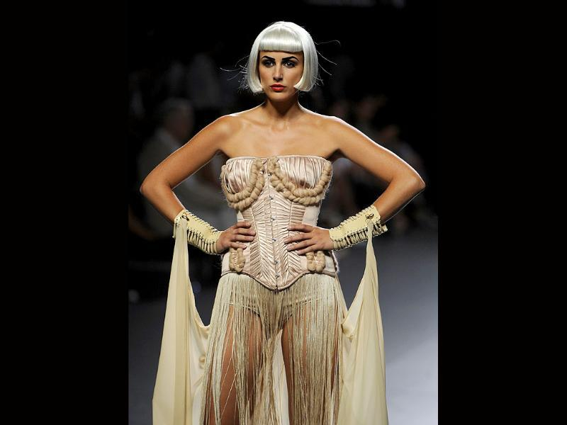 A model displays an outfit by Spanish designer Maya Hansen during the Cibeles Madrid Fashion Week.