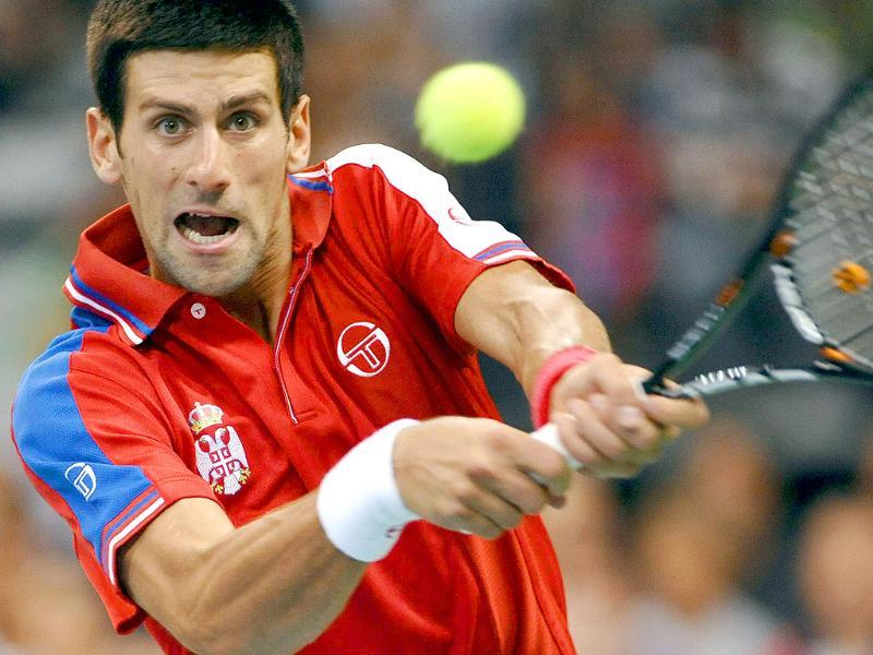 Serbia's Novak Djokovic returns the ball against Argentina's Juan Martin Del Potro during their Davis Cup semifinal match at Belgrade Arena.