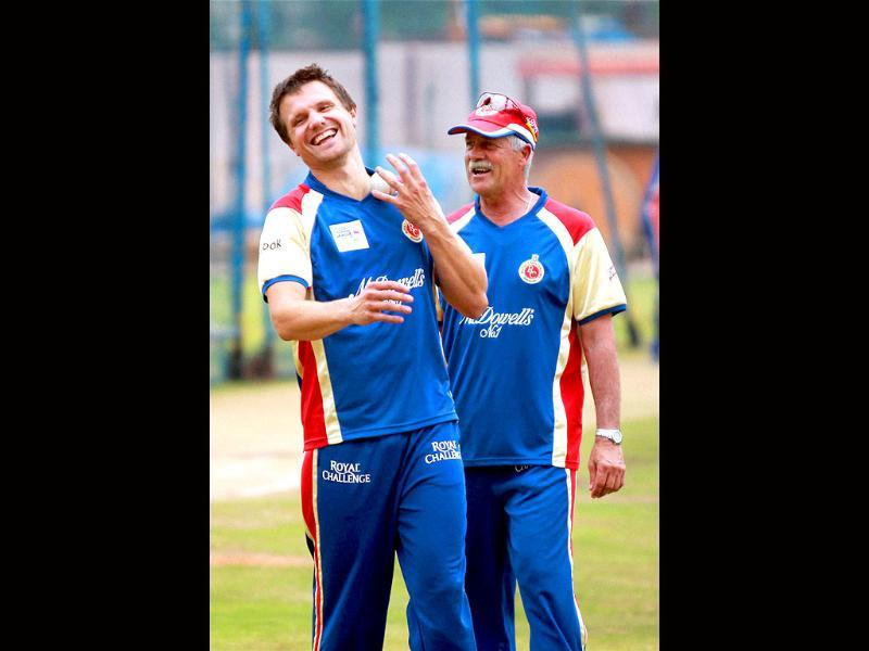 Royal Challengers Bangalore player Dirk Nannes with coach Ray Jenning during a practice session for Champions league 2011 at National Cricket Academy ground in Bangalore.