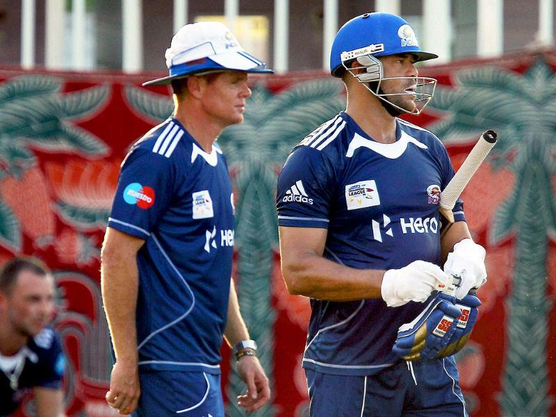 Mumbai Indians coach Shaun Pollock and player Andrew Symonds during a practice session for Champions League 2011 at MAC Stadium in Chennai.