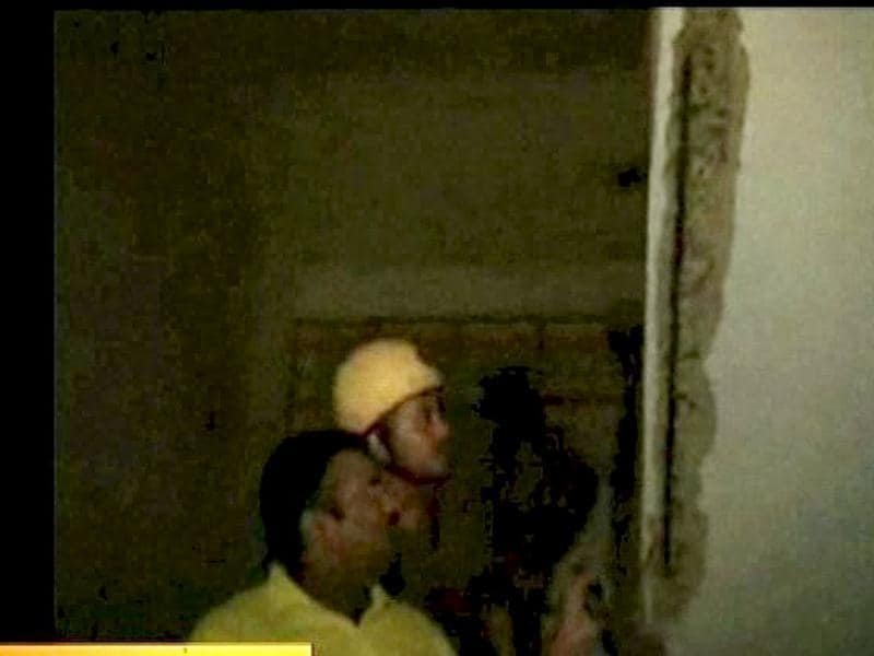 **TV GRAB** Fire personal showing crack wall, after an earthquake occurred in Kolkata. An earthquake of 9 intensity measuring 6.8 on Richter Scale with its epicenter on the Sikkim-Nepal border shook northeast and northern parts of the country, including the national capital.