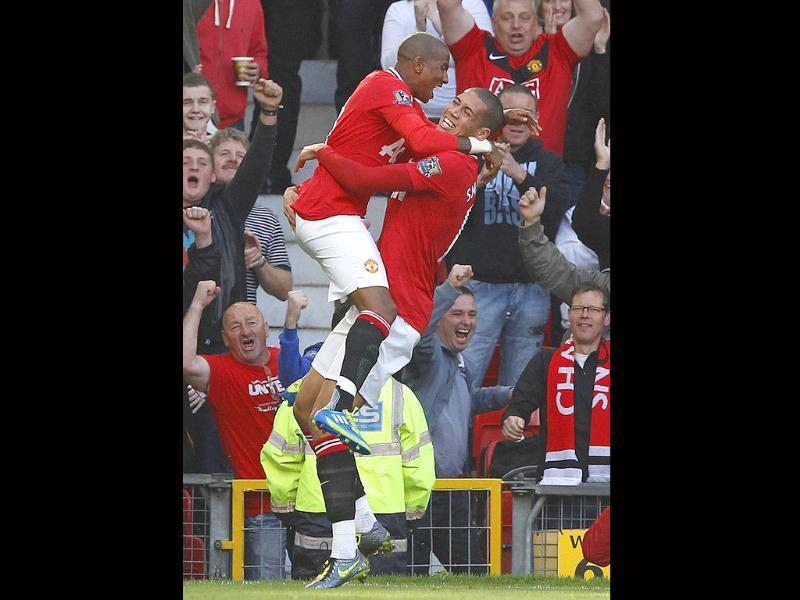Manchester United's Chris Smalling (R) celebrates scoring with Ashley Young against Chelsea during their English Premier League soccer match in Manchester.