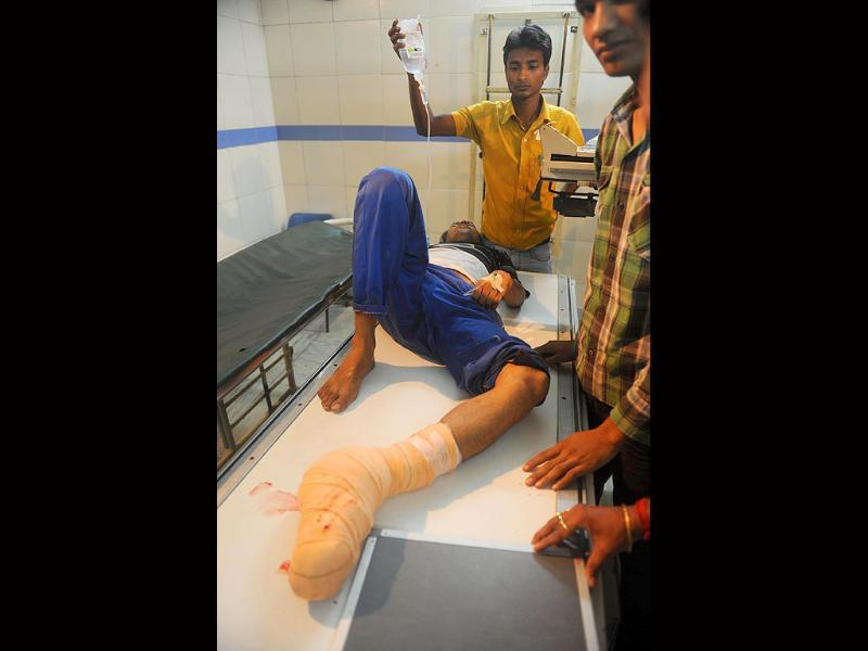 An injured man lies on a medical gurney in a hospital in Siliguri after an earthquake hit Sikkim.