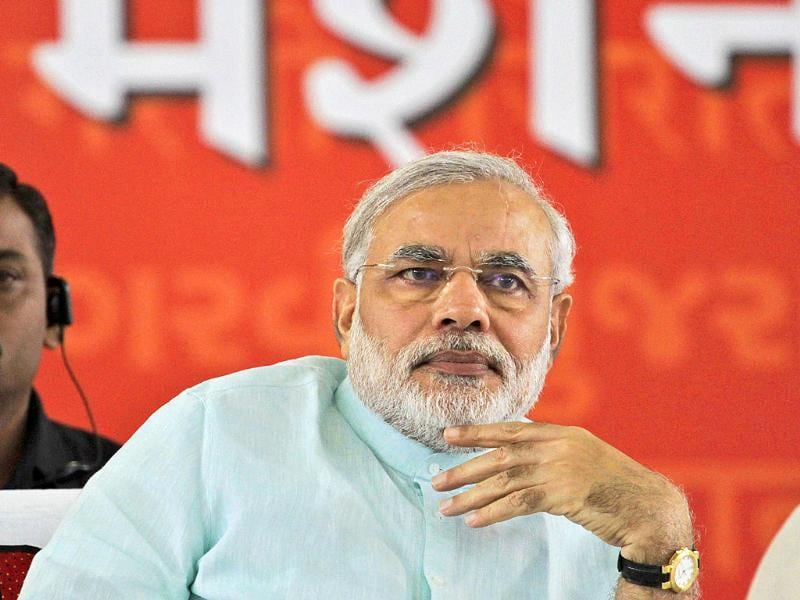 Gujarat chief minister Narendra Modi who is on the second day of his fast looks on in Ahmedabad.