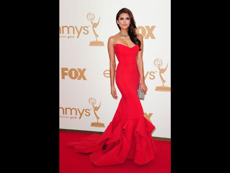 Actor Nina Dobrev looks svelte and sexy in red as she arrives at the 63rd annual Emmy Awards in Los Angeles. (AFP)