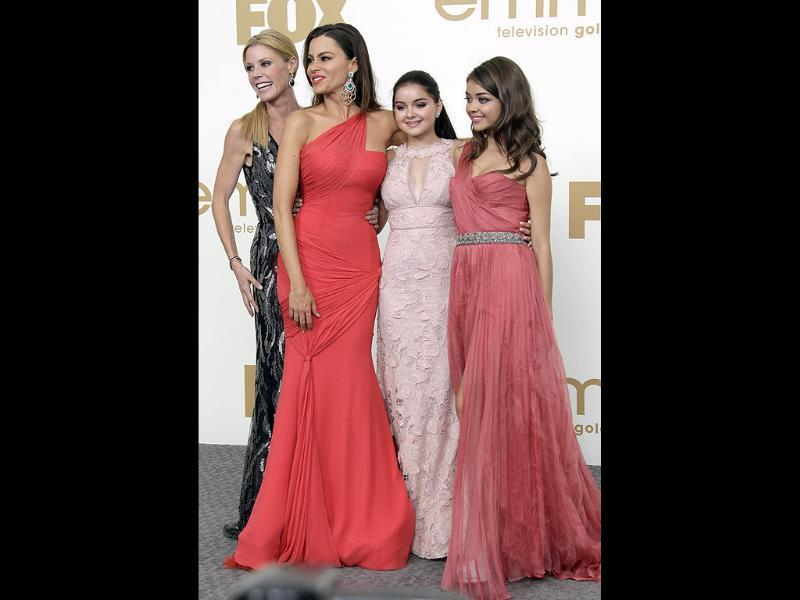 Modern Family cast members from left, Julie Bowen, Sofia Vegara, Ariel Winter and Sarah Hyland pose backstage at Emmy Awards. (AP)