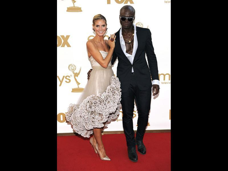 Heidi Klum, left, and Seal arrive at the 63rd Emmy Awards in Los Angeles. (AP Photo)