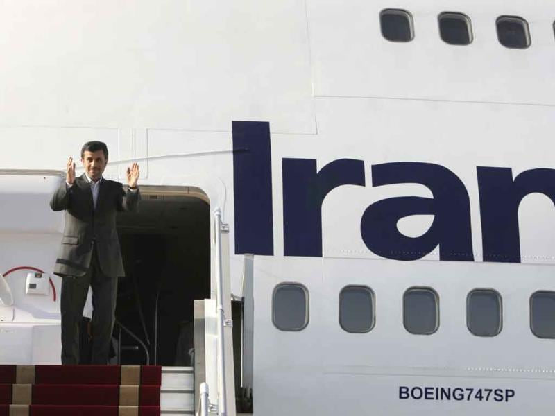 Iranian President Mahmoud Ahmadinejad, waves to media and officials, as he boards his plane leaving Tehran's Mehrabad airport for New York to attend the UN General Assembly.