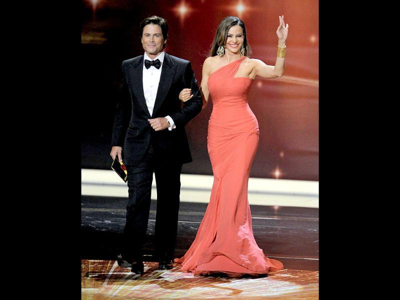 Rob Lowe, left, and Sofia Vergara are seen onstage at the 63rd Primetime Emmy Awards on Sunday. (AP)