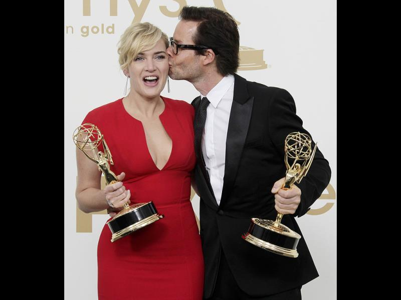 Mildred Pierce cast members Kate Winslet, left and Guy Pearce hold the Emmys for best actress and best supporting actor in a miniseries. (AP)