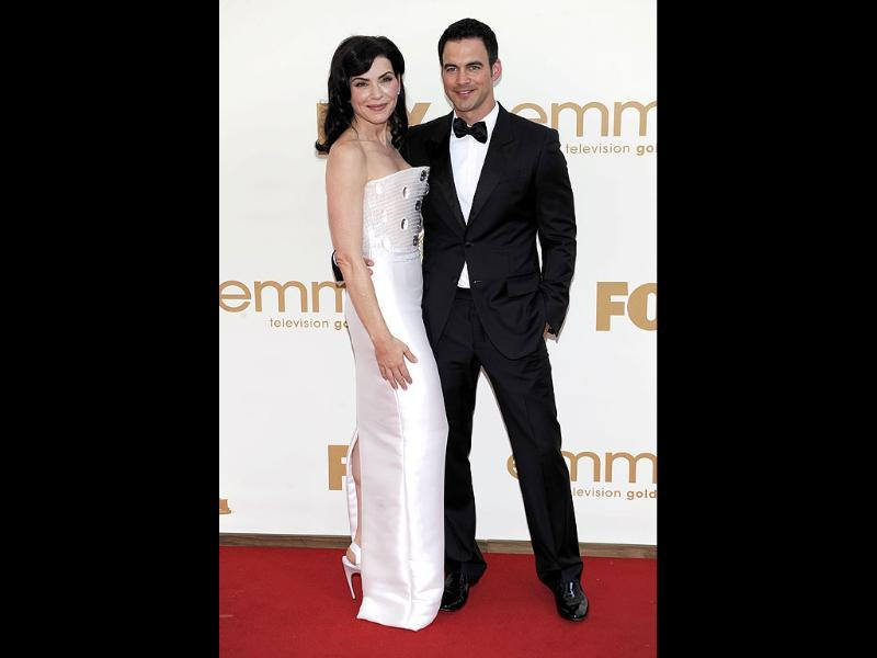 Julianna Margulies, left, and Keith Lieberthal arrive at the 63rd Primetime Emmy Awards. (AP)