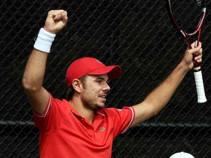Stanislas Wawrinka of Switzerland celebrates after defeating Lleyton Hewitt of Australia in the fifth and final match of their Davis Cup world group play-off tie in Sydney.