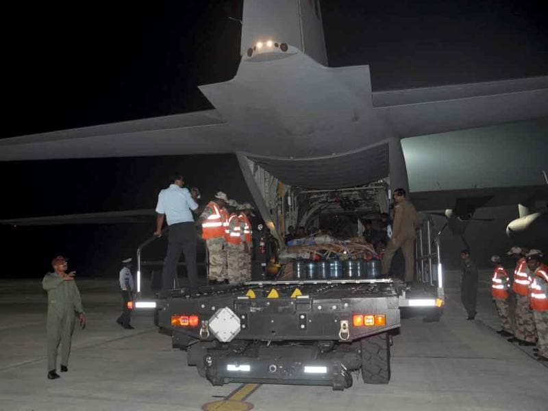 Rescue equipments and material being loaded on an aircraft for the North-East quake victims.