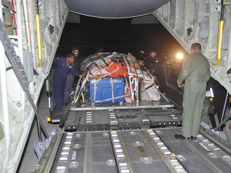 Rescue equipments and materials being loaded on a aircraft for the North-East quake victims.