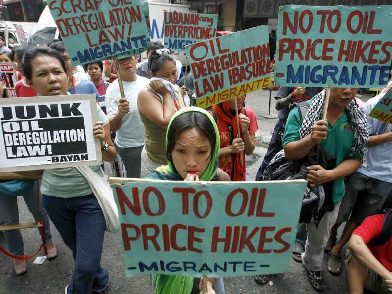 Supporters of a transport strike hold signs as they rally along a road in Quezon City, Metro Manila.