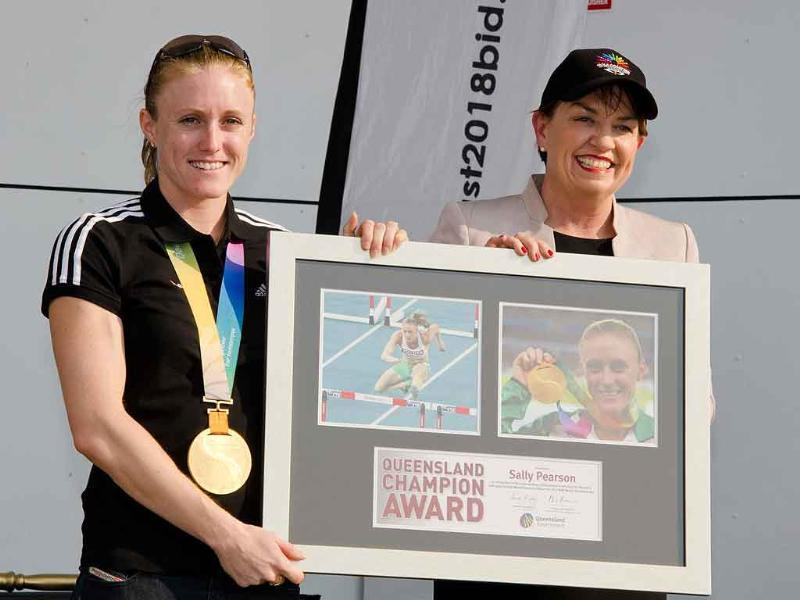 Queensland state Premier Anna Bligh (R) poses with 100 metres hurdles world champion Sally Pearson (L) during a welcome home ceremony in Gold Coast City.