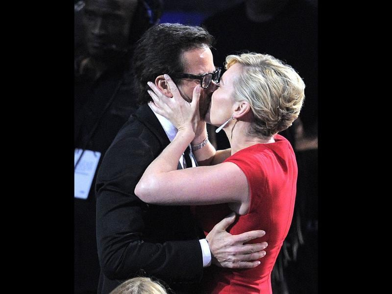 Guy Pearce kisses costar Kate Winslet before accepting the award for outstanding supporting actor in a miniseries or a movie for Mildred Pierce. (AP)