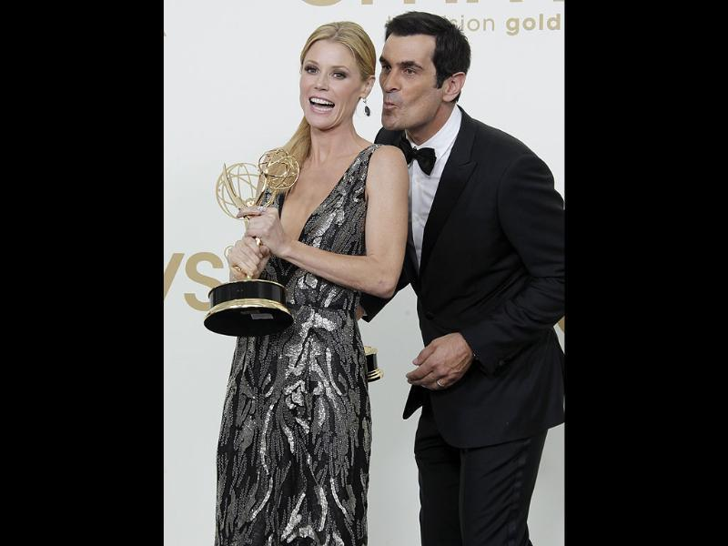 Ty Burrell, left, Julie Bowen from the television series Modern Family hold their Emmys for best supporting and actress actress in a comedy. (AP)