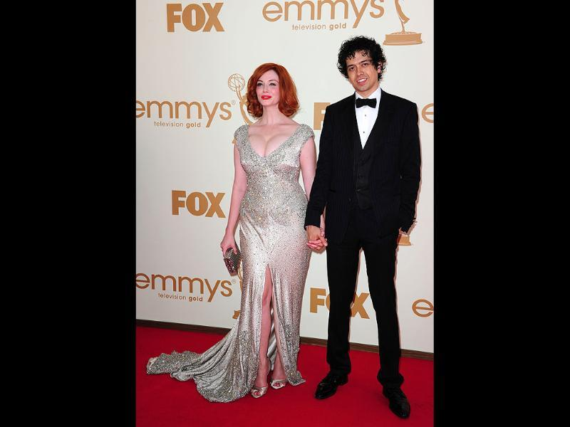 Actress Christina Hendricks and husband Geoffrey Arend arrive at the 63rd annual Primetime Emmy Awards. (AFP)