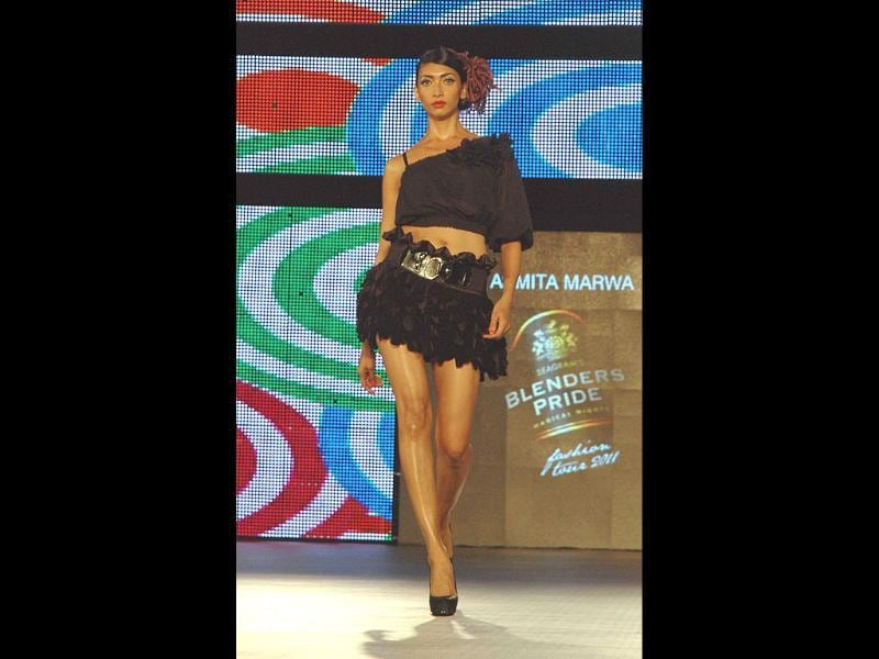 Designer Ashmita Marwah brings salsa glam to stage in black outfit.
