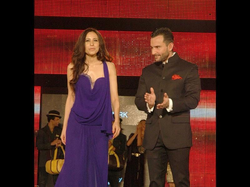 Saif Ali Khan with designer Mandira Wirk during the Blenders Pride Fashion Tour 2011 in New Delhi on Saturday night. UNI PHOTO