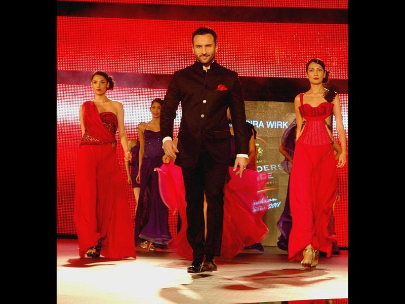 Saif Ali Khan rocked the ramp in true Bollywood style at the Blenders Pride Fashion Tour 2011 in New Delhi. Check out the stylebook of the event. UNI PHOTO