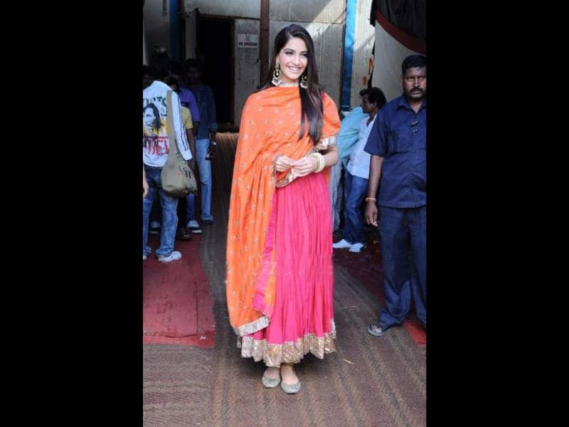 Sonam Kapoor, on the sets of India's Got Talent, looks pretty in an orange and pink anarkali suit.