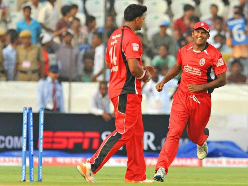 Trinidad and Tobago captain Darren Ganga (R) and bowler Ravi Rampaul celebrate the wicket of JGA Janoda of Ruhunu XI, during the Champions League Twenty20 League cricket qualifying pool match between Trinidad and Tobago and Ruhunu XI at the Rajiv Gandhi International Stadium in Hyderabad.