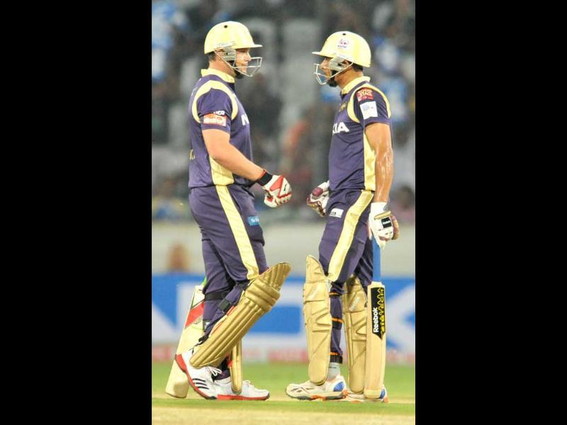 KKR cricketers Manvinder Bisla (R) and Jacques Kallis talk during the Champions League Twenty20 qualifying cricket pool match between Kolkata Knight Riders and Auckland Aces at the Rajiv Gandhi International Stadium in Hyderabad.