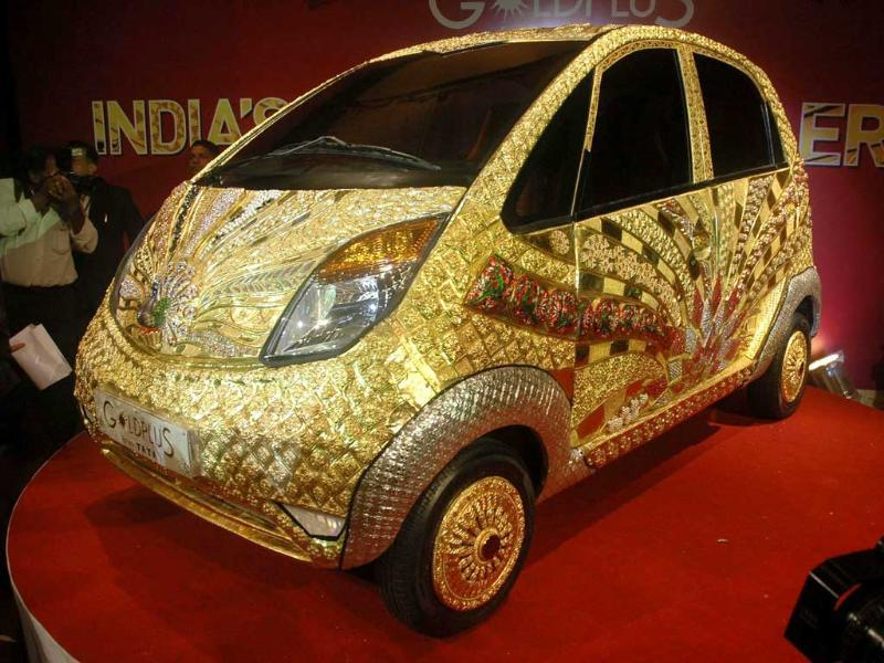 Media persons capture pictures of the Goldplus Nano, the world's first ever pure gold jewellery car launched by Tata Group in Mumbai.