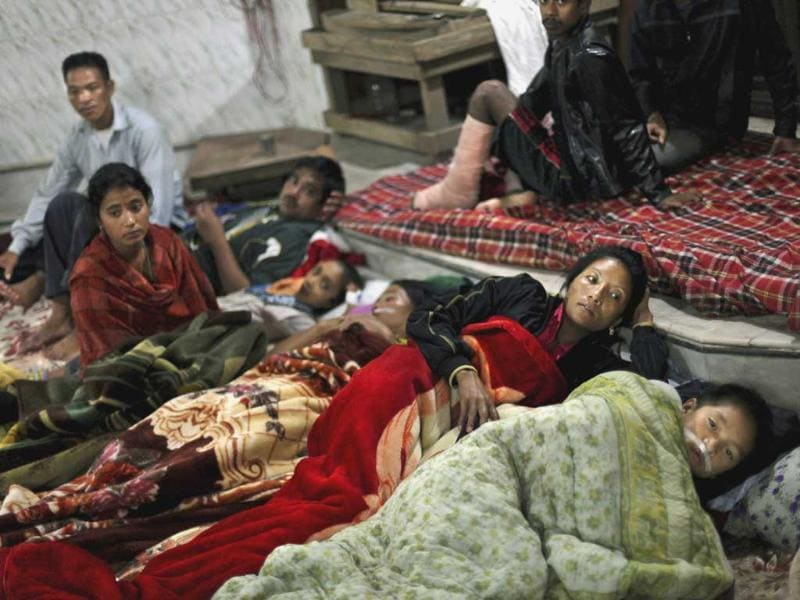Residents and patients from a local hospital take shelter in a temple after Sunday's earthquake in Gangtok.