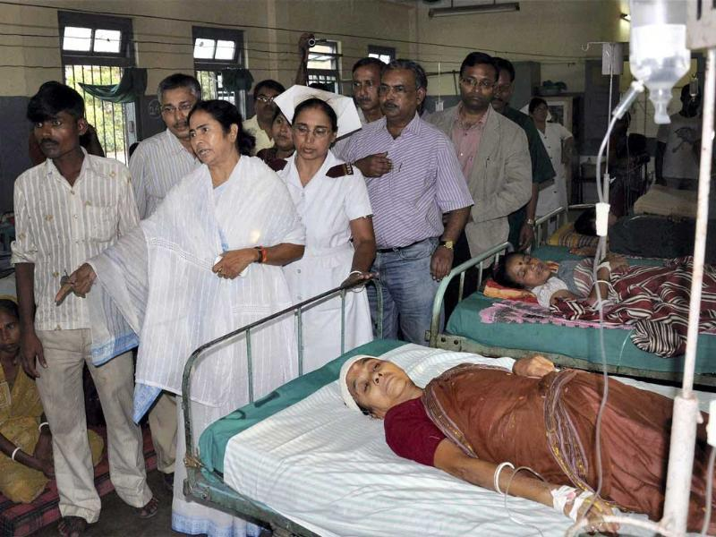 West Bengal chief minister Mamta Banerjee visits people injurered in Sunday's earthquake at a hospital in Siliguri.